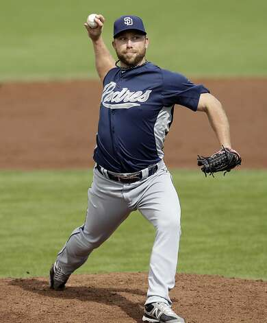 San Diego Padres relief pitcher Dale Thayer throws to the San Francisco Giants during a spring training baseball game Sunday, March 18, 2012 in Scottsdale, Ariz. (AP Photo/Marcio Jose Sanchez) Photo: Marcio Jose Sanchez, Associated Press