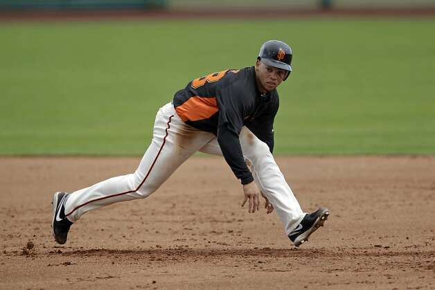San Francisco Giants' Juan Perez in action against the San Diego Padres during a spring training baseball game Sunday, March 18, 2012 in Scottsdale, Ariz. (AP Photo/Marcio Jose Sanchez) Photo: Marcio Jose Sanchez, Associated Press