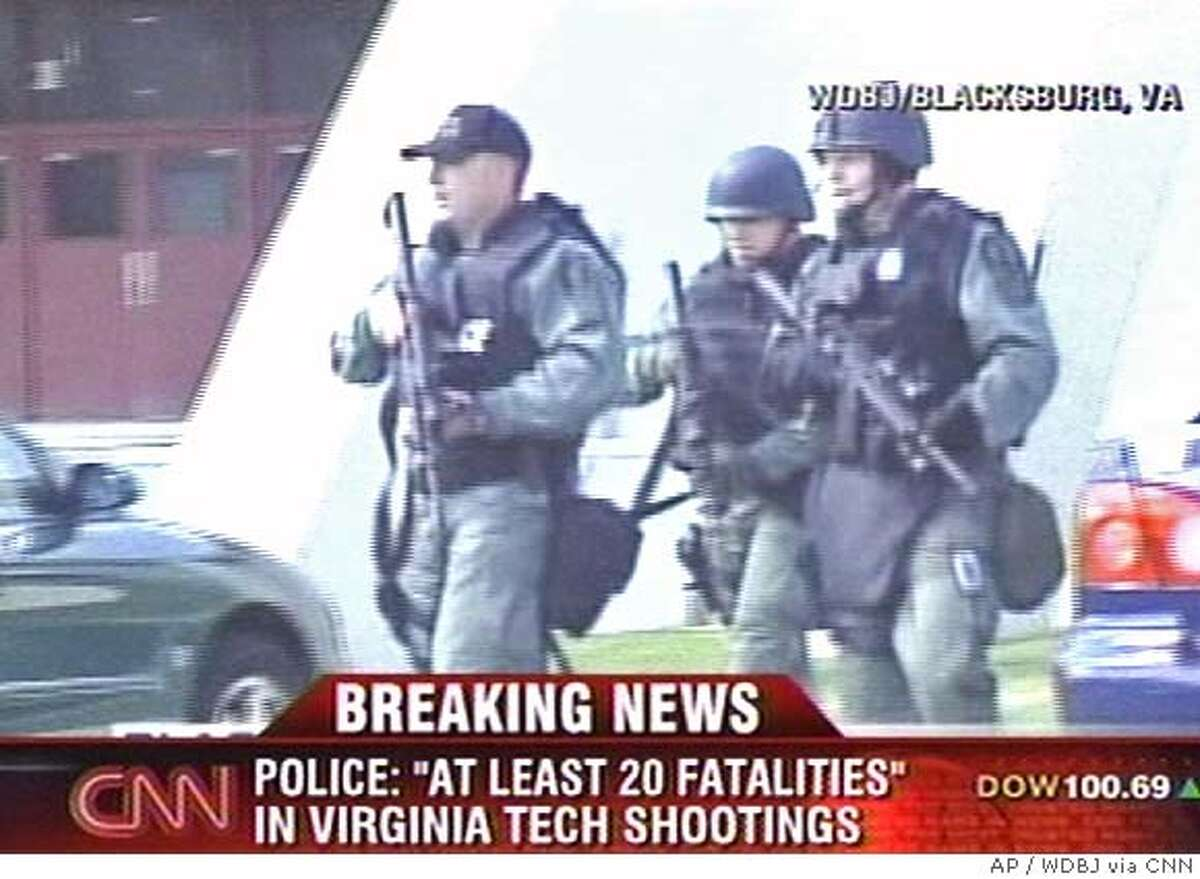 Law enforcement officers arrive at the scene of a shooting at the Virginia Tech campus in Blacksburg, Va. Gunfire erupted in a dorm and classroom at Virginia Tech on Monday, killing 22 people, the police chief said. The gunman was killed. (AP Photo/WDBJ via CNN) ** MANDATORY CREDIT: WDBJ via CNN ** NO SALES; TV OUT; MANDATORY CREDIT: WDBJ VIA CNN