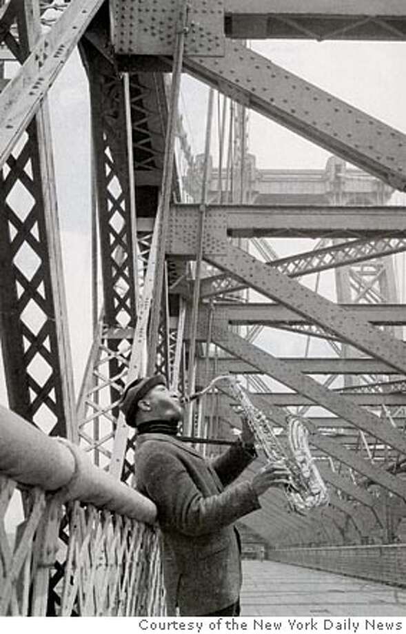Sonny Rollins playing on the Williamsburg Bridge, 1966  Courtesy of the New York Daily News