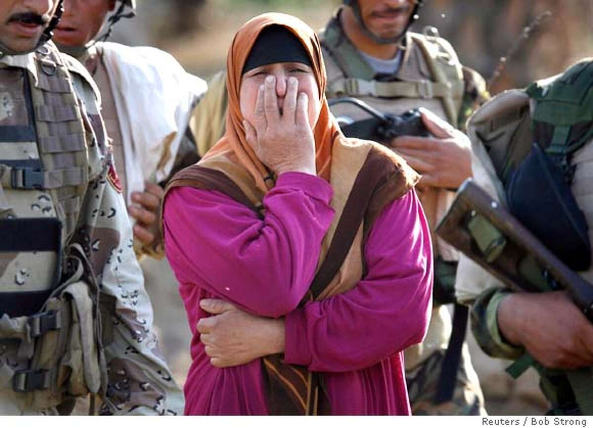 A woman cries after U.S. and Iraqi army soldiers took her teenage son for questioning during a sweep through an area near Mahmudiya, south of Baghdad, April 16, 2007. REUTERS/Bob Strong (IRAQ) Ran on: 04-17-2007 A woman cries after U.S. and Iraqi troops took her teenage son for questioning during a sweep south of Baghdad.
