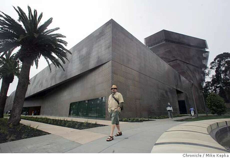 "deyoung125_mk.JPG  Ted Woodward, of San Francisco, walks past the new De Young museum. ""I'm going to give it couple of years,"" said Woodward, ""It reminds me of a Marriott or something."" Golden Gate park is filled with excited city dwellers who are ready for the new De Young museum to open at noon Saturday. date} Mike Kepka / The Chronicle MANDATORY CREDIT FOR PHOTOG AND SF CHRONICLE/ -MAGS OUT Photo: Mike Kepka"