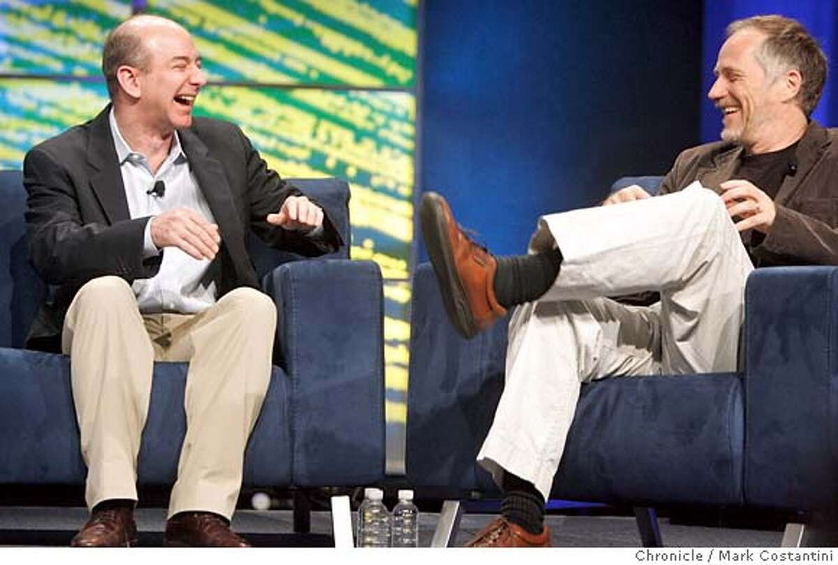 Today is the Web 2.0 Expo at Moscone West in San Francisco. Keynote speaker Jeff Bezos (left), the founder and CEO of Amazon.com shares a laugh with Tim O'Reilly, founder an CEO of O'Reilly Media, Inc. after Bezos's keynote speech. PHOTO: Mark Costantini / The Chronicle Jeff Bezos (cq) Tim O'Reilly (cq) MANDATORY CREDIT FOR PHOTOGRAPHER AND SAN FRANCISCO CHRONICLE/NO SALES-MAGS OUT
