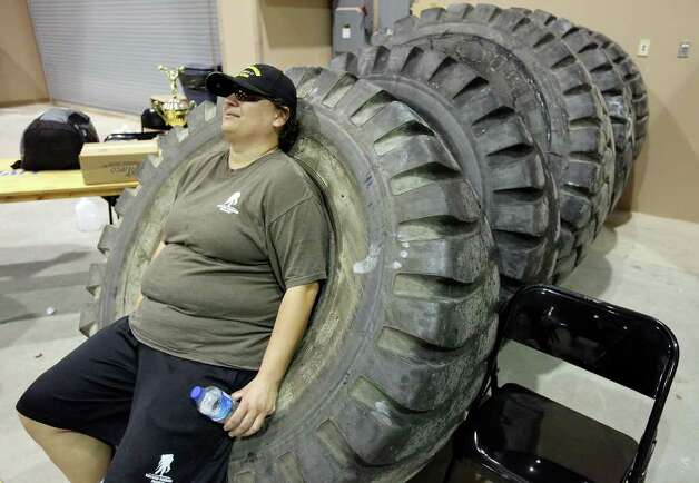 U.S. Army veteran and wounded warrior Artemis O'Conan, 30, relaxes on tires used in the tire flip after the Shamrock Strength Showdown part of the San Antonio AutoRama & South Texas Motorcycle Show Sunday March 18, 2012 at the Freeman Coliseum. Photo: EDWARD A. ORNELAS, SAN ANTONIO EXPRESS-NEWS / © SAN ANTONIO EXPRESS-NEWS (NFS)