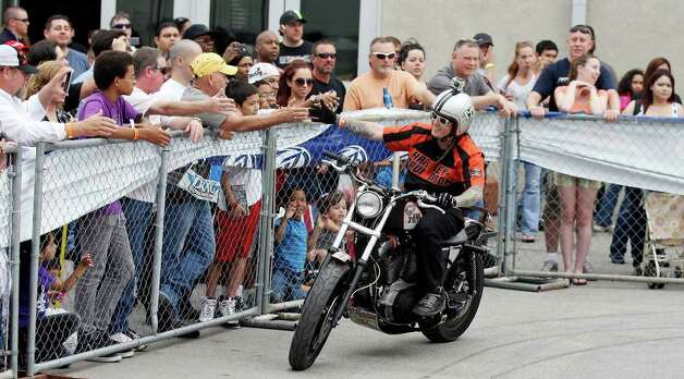 King Tony greets spectators during the Busted Knuckles Stunt Tour part of the San Antonio AutoRama & South Texas Motorcycle Show Sunday March 18, 2012 at the Freeman Coliseum. Photo: EDWARD A. ORNELAS, SAN ANTONIO EXPRESS-NEWS / © SAN ANTONIO EXPRESS-NEWS (NFS)