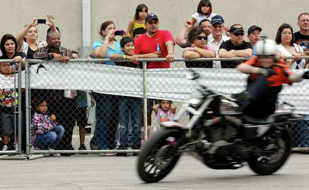 Spectators watch King Tony perform during the Busted Knuckles Stunt Tour part of the San Antonio AutoRama & South Texas Motorcycle Show Sunday March 18, 2012 at the Freeman Coliseum. Photo: EDWARD A. ORNELAS, SAN ANTONIO EXPRESS-NEWS / © SAN ANTONIO EXPRESS-NEWS (NFS)