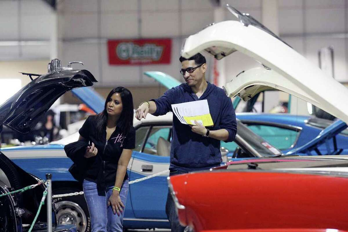 Michelle Keosouvanh (CQ) (left) and Mario Morales take in the sights during the San Antonio AutoRama & South Texas Motorcycle Show Sunday March 18, 2012 at the Freeman Coliseum.
