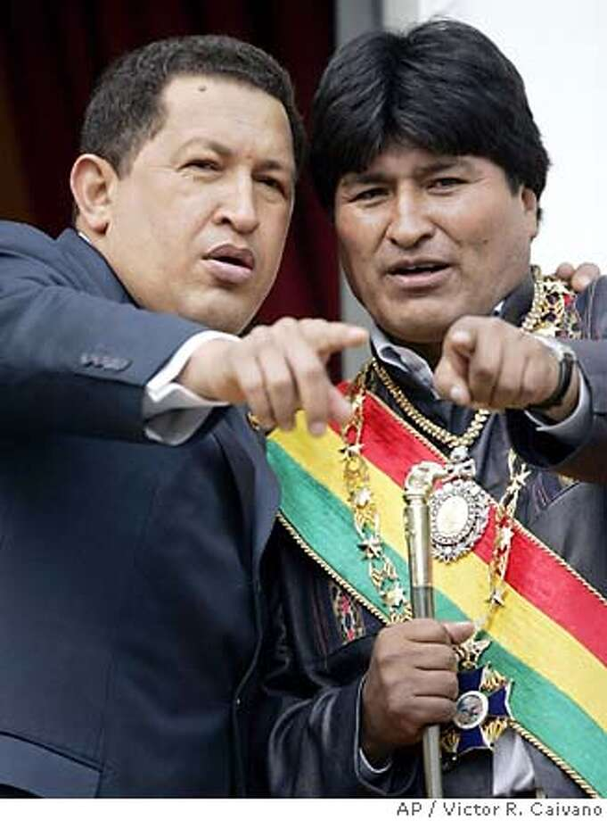 Venezuela's President Hugo Chavez, left, stands next to Bolivian President Evo Morales, right, as they stand in the balcony of the presidencial palace in La Paz, Bolivia on Sunday, January 22, 2006. (AP Photo/Victor R. Caivano) Ran on: 01-23-2006  Photo caption MUST END WITH See story, Page A3. Ran on: 01-23-2006  Photo caption MUST END WITH See story, Page A3. **EFE OUT** Photo: VICTOR R. CAIVANO