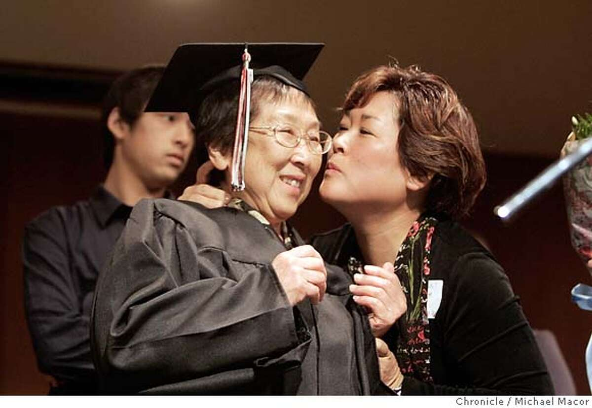 degree_017_mac.jpg Esther in cap and gown gets a kiss from her daughter Lori Smeenge during the diploma presentation. 83 year old, Esther Nozaki Hashimoto, was in for a big surprise this morning when she received her High School diploma after a 54 year wait. Esther, of Japanese descent, was in her junior year at Mountain View Academy when she and her family were removed from the area and ordered into an internment camp during World War II. Photographed in, Mountain View, Ca, on 4/14/07. Photo by: Michael Macor/ The Chronicle Mandatory credit for Photographer and San Francisco Chronicle No sales/ Magazines Out