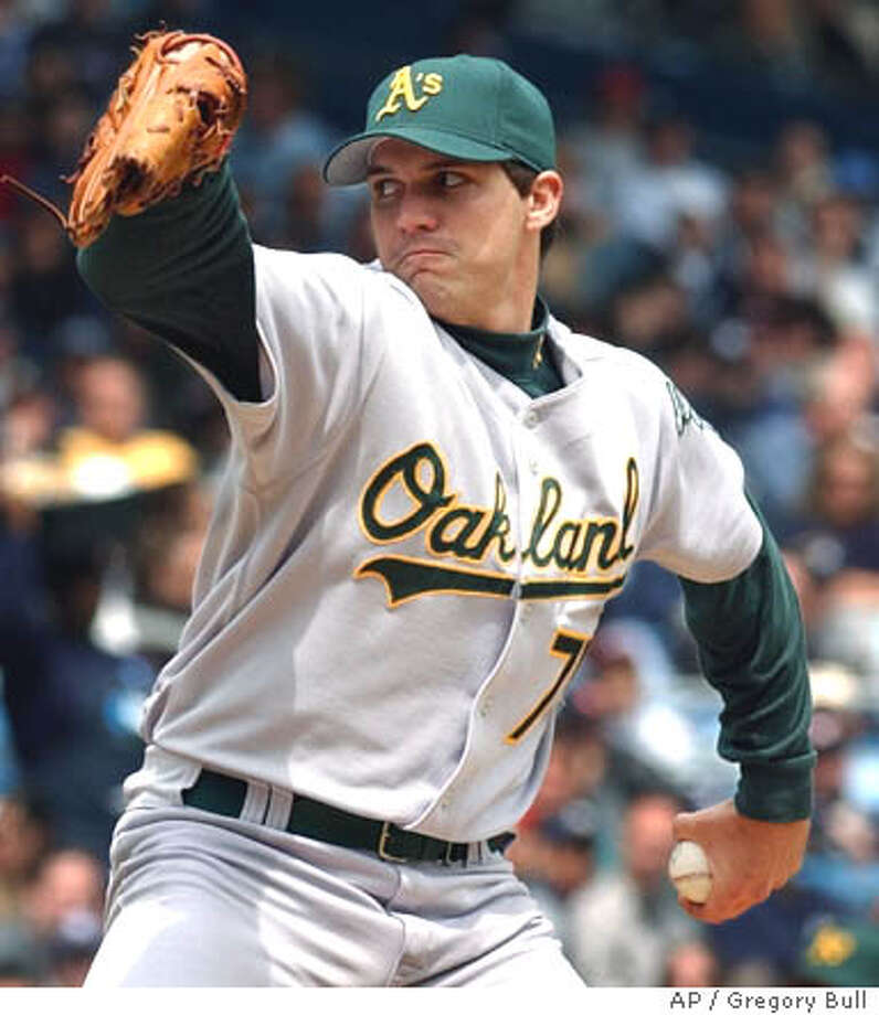 Oakland Athletics pitcher Barry Zito throws in the first inning against the New York Yankees at Yankee Stadium in New York Sunday, May 4, 2003. Zito outdueled Roger Clemens in a marquee matchup of the last two AL Cy Young winners, blanking baseball's top-scoring team for eight innings and pitching the Oakland Athletics over the New York Yankees 2-0. (AP Photo/Gregory Bull) Photo: GREGORY BULL