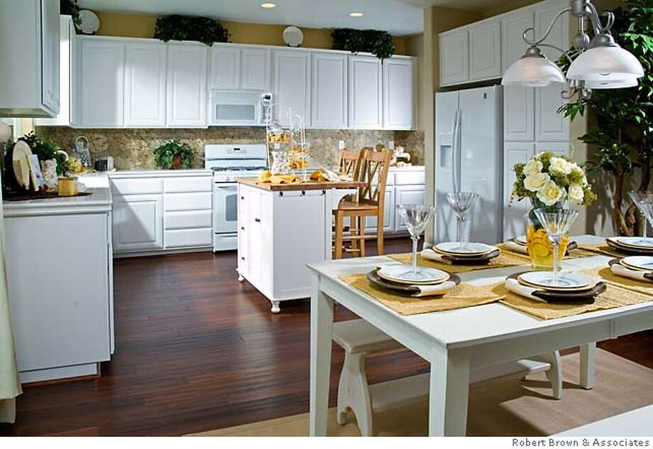 Kitchen of the Kimball II model. It's the mid-price model at Valley Ranch, in fast-growing Williams (Colusa County). Folks willing to move to what is essentially farmland, can get new homes for $152 a square foot. Photo: Robert Brown & Associates