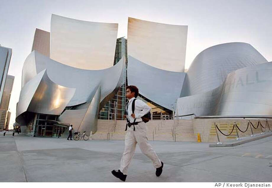 ** FOR USE ANYTIME **A man walks past the new Walt Disney Concert Hall in downtown Los Angeles, Tuesday, Oct. 14, 2003. The hall, designed by renowned architect Frank Gehry, has its official opening on Oct. 23 with a debut concert by the Los Angeles Philharmonic. (AP Photo/Kevork Djansezian) FOR USE ANYTIME. A man walks past the new Walt Disney Concert Hall in downtown Los Angeles. Ran on: 10-13-2005  The Walt Disney Concert Hall, designed by Frank Gehry, is part of a self-guided walking tour in downtown Los Angeles. Photo: KEVORK DJANSEZIAN