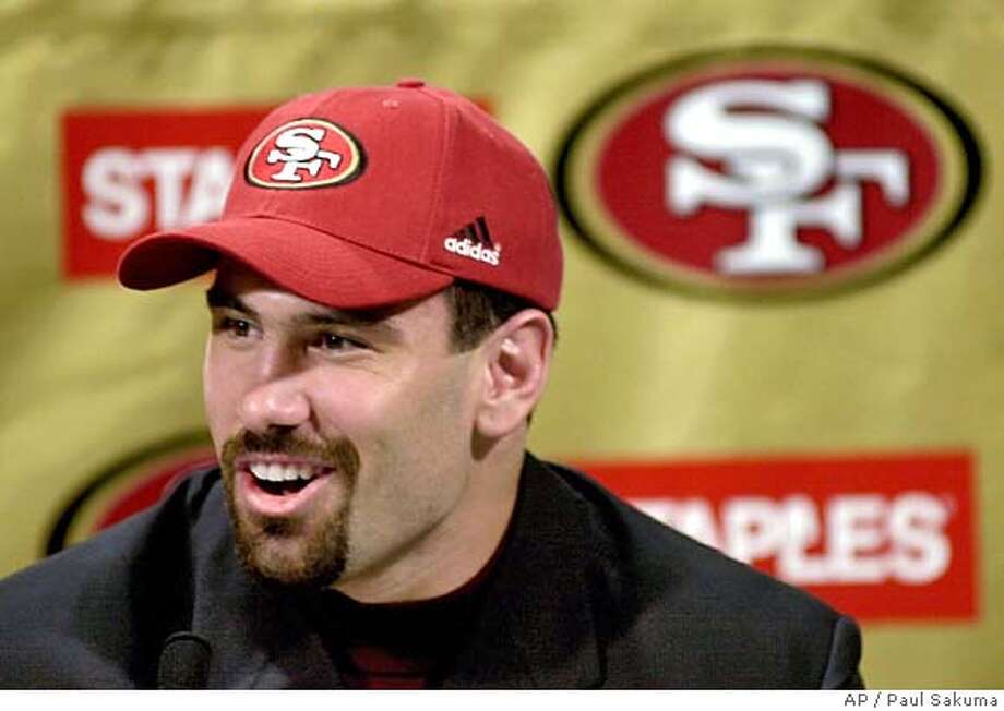 San Francisco 49ers third-round draft pick Jeff Ulbrich, an inside linebacker at Hawaii, smiles at a news conference at 49ers' headquarters in Santa Clara, Calif., Sunday, April 16, 2000. Ulbrich is a native of San Jose. (AP Photo/Paul Sakuma) CAT Photo: PAUL SAKUMA