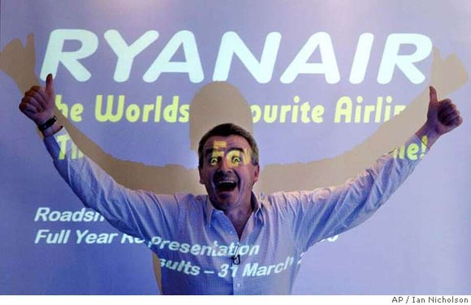 Ryanair Chief Executive Michael O'Leary announces the company's annual profits at a press conference in London Tuesday June 6, 2006. Ryanair lifted annual profits but warned soaring oil prices would cut into the coming year's performance, Europe's most rapidly expanding airline, reported a 12.5 percent gain in full-year net profits to euro301.5 million (US$389 million) Tuesday, despite absorbing a strong increase in the cost of jet fuel. (AP Photo / Ian Nicholson, PA) ** UNITED KINGDOM OUT - NO SALES - NO ARCHIVES ** UNITED KINGDOM OUT NO SALES NO ARCHIVE PHOTOGRAPH CANNOT BE STORED OR USED FOR MORE THAN 14 DAYS AFTER THE DAY OF TRANSMISSION Photo: IAN NICHOLSON