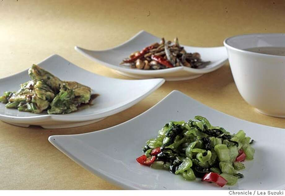 From foreground to back: Chile pickled mustard greens, Garlic chive omlet, Crisp anchovies with peanuts. Story about traditional Chinese porridge with toppings. Five recipes for toppings, plus the rice porridge.  Please shoot lede -- all together -- and 5 individual recipes for jump and detail.  Amanda Bowman to style, with Elie Winter art-directing.  Photo taken on 9/19/05 in San Francisco, CA. Photo by Lea Suzuki/ The San Francisco Chronicle Photo: Lea Suzuki