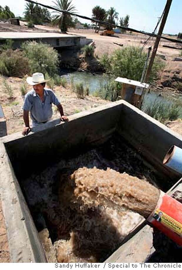 Mexicali, Mexico-June 13: NazarioOrtizz looks over water being pumped from a seepage canal in the village of Netzahualcoyotl(CQ), on the outskirts of Mexicali, Mexico Tuesday, June 13, 2006. This village relies soley on seepage water for personal usage as well as agricultural use. The San Diego Water Authority has plans to line a 23 Mile stretch of the All American Canal which would stop seepage flow to Mexico and thousands of Mexican farmers out of business. Sandy Huffaker / Special to The Chronicle MANDATORY CREDIT FOR PHOTOGRAPHER AND SAN FRANCISCO CHRONICLE/NO SALES - MAGS OUT Photo: Sandy Huffaker