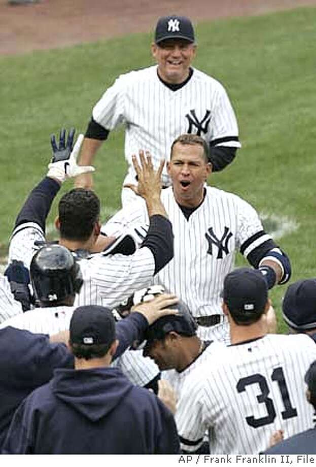 New York Yankees' Alex Rodriguez, center, is greeted at home plate by teammates after hitting a game-winning grand slam in the ninth inning of baseball action against the Baltimore Orioles Saturday, April 7, 2007 at Yankee Stadium in New York. The Yankees won the game 10-7. (AP Photo/Frank Franklin II) Photo: Frank Franklin II