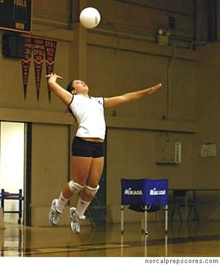 Here is the picture from norcalprepscores.com of Kristen Kathan jump serving. I'm still searching for the head shot. I'll get it to you by tomorrow. Any questions call 925-376-4196 LeeAnn