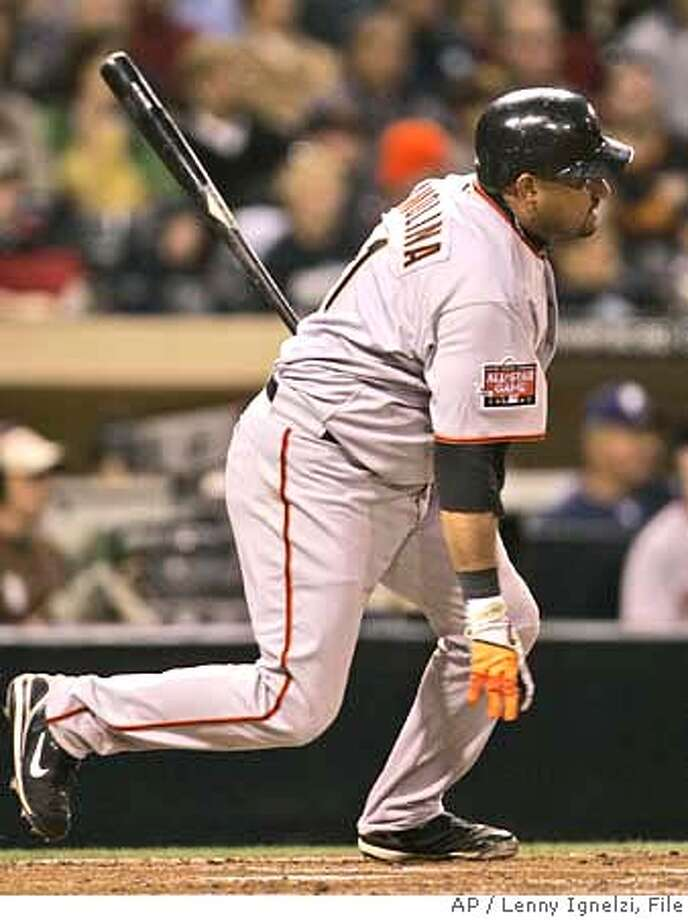San Francisco Giants' Bengie Molina watches his RBI single go into left field in the second inning against the San Diego Padres during their baseball game in San Diego, Tuesday, April 10, 2007. Molina drove in two runs by the fourth inning. (AP Photo/Lenny Ignelzi) EFE OUT Photo: Lenny Ignelzi