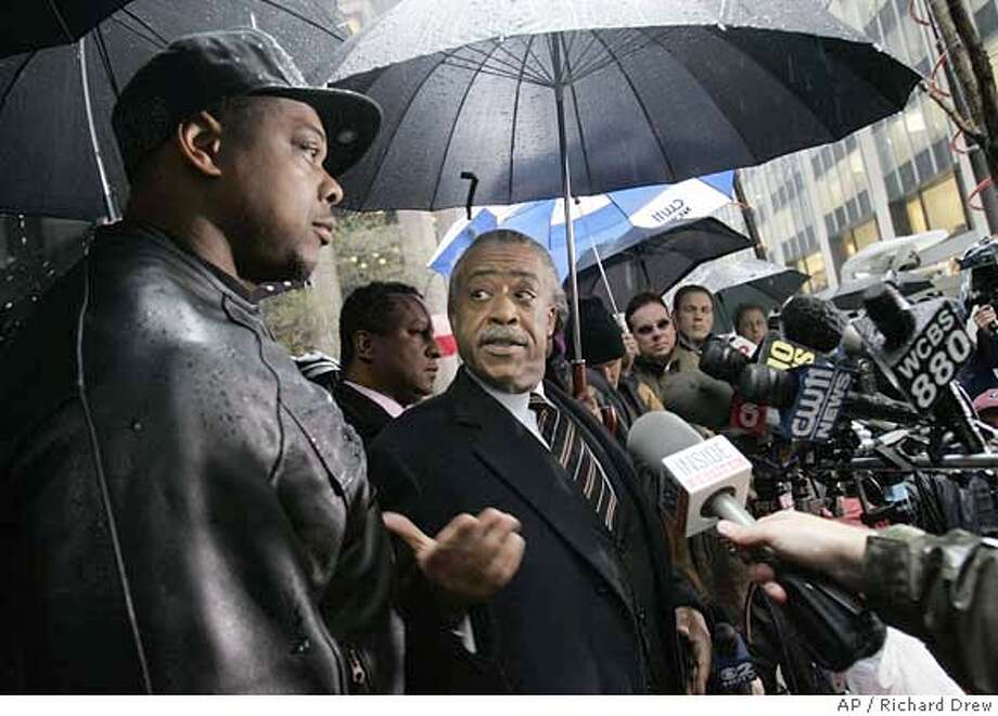 "Rev. Al Sharpton, center, gestures toward Linzell Vaughn, left, father of Rutgers sophomore basketball center Kia Vaughn, as they face the press outside CBS headquarters in New York before they met with CBS executive Les Moonves, Thursday, April 12, 2007, about remarks made by radio personality Don Imus. CBS Radio, which has suspended Imus for two weeks without pay beginning next week, said it would ""continue to speak with all concerned parties and monitor the situation closely."" (AP Photo/Richard Drew) Photo: RICHARD DREW"