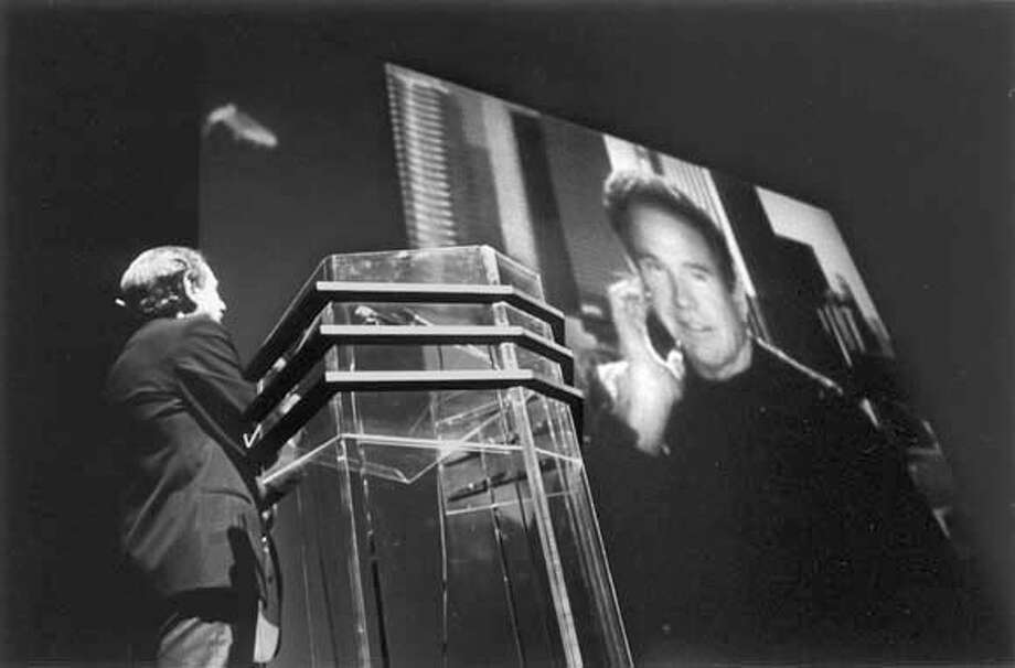 Arthur Penn, the 1996 San Francisco Film Festival Akira Kurosawa award recipient, conversing with Warren Beatty through remote video system during the award ceremony. Photo: File