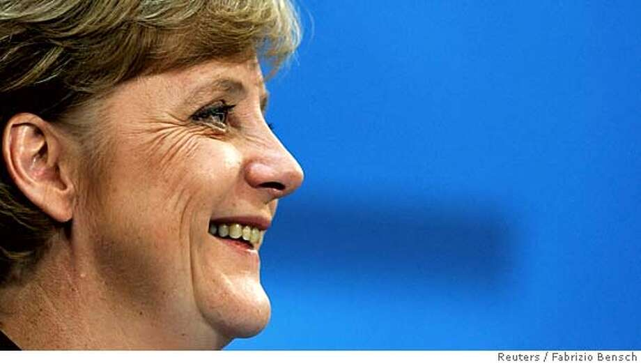 Angela Merkel, leader of Germany's conservative Christian Democratic Union party (CDU) smiles as she addresses a news conference following a party leaders meeting in Berlin October 10, 2005. The leadership of Merkel's conservative CDU has approved the start of formal coalition negotiations with Germany's Social Democrats, Merkel said on Monday. REUTERS/Fabrizio Bensch 0 Photo: FABRIZIO BENSCH