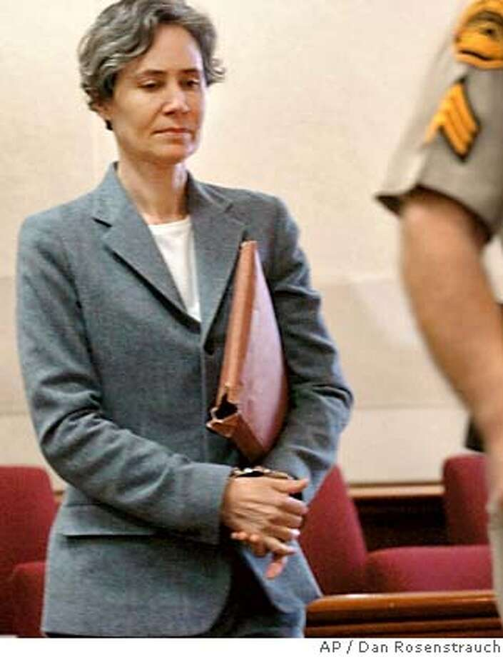 Susan Polk walks into court on the first day of her murder trial Tuesday morning, Oct. 11, 2005, in Martinez, Calif. Polk is accused of murder in the death of her 70-year-old husband. (AP Photo/Dan Rosenstrauch, Pool) POOL PHOTO Photo: DAN ROSENSTRAUCH