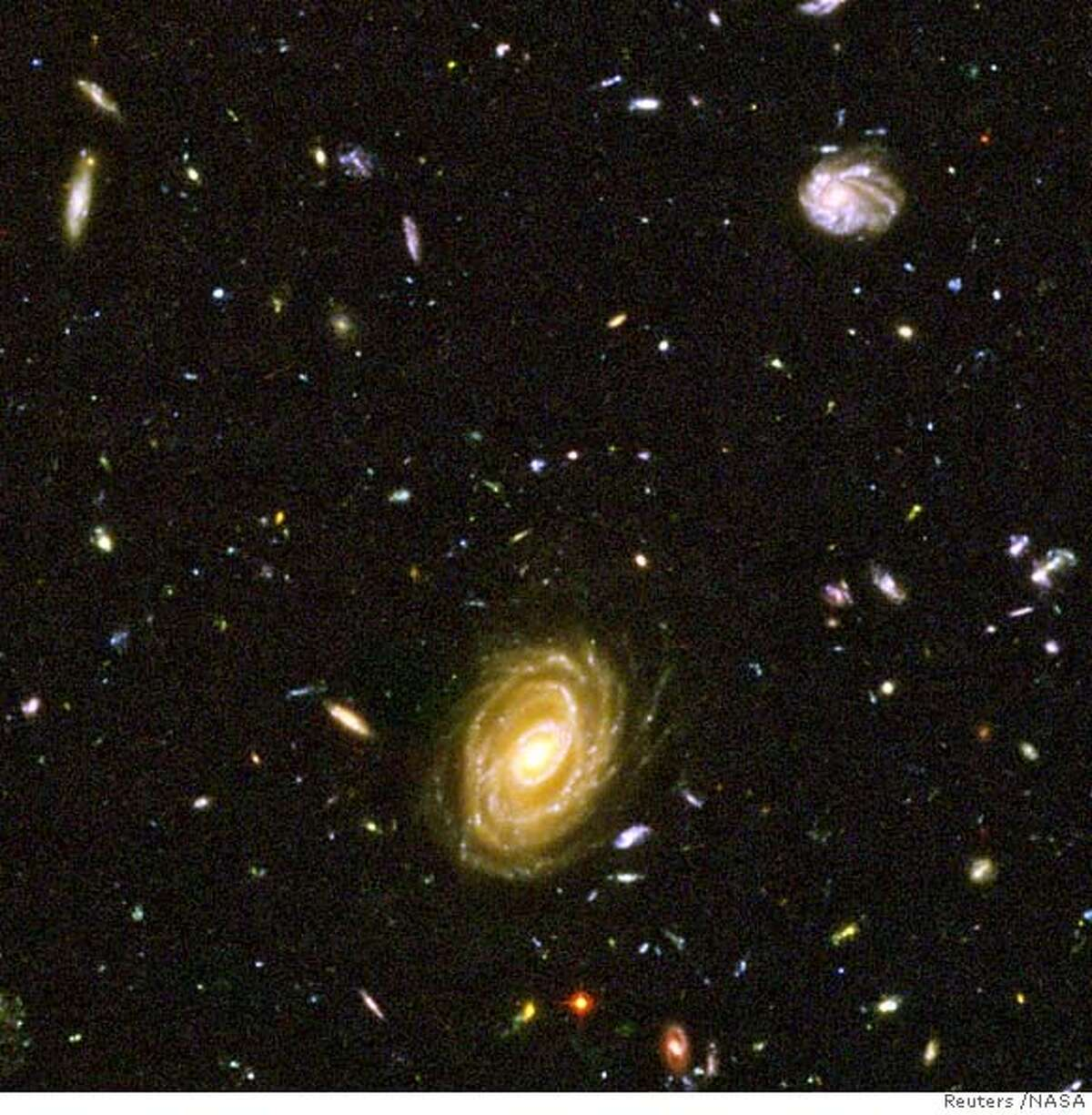 Astronomers using two of NASA's most powerful telescopes said on September 27, 2005, they have detected a