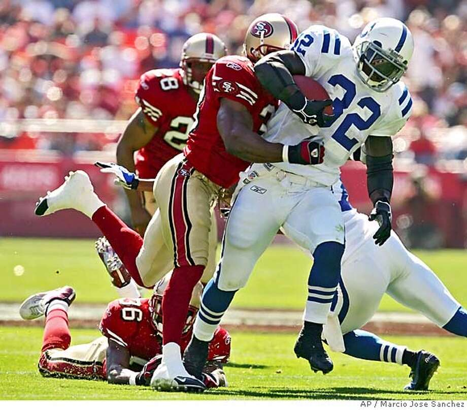 Indianapolis Colts running Back Edgerrin James (32) rumbles for 33 yards while being tackled by the San Francisco 49ers' Tony Parrish, middle, in the first half on Sunday, Oct. 9, 2005 in San Francisco. (AP Photo/Marcio Jose Sanchez) Photo: MARCIO JOSE SANCHEZ