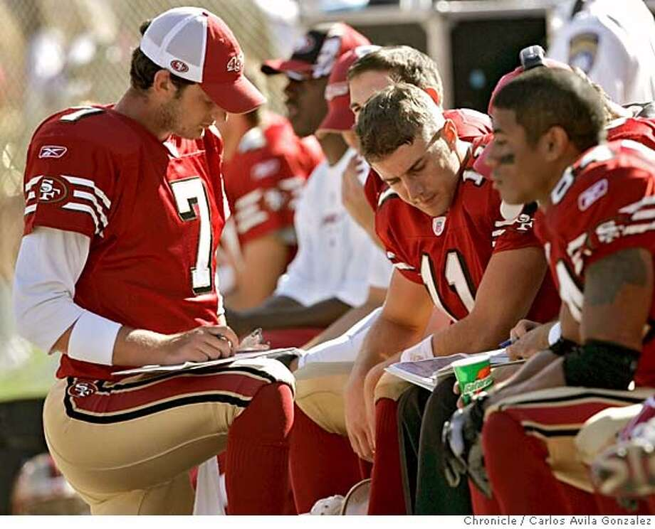 49ers_014_CG.JPG  49ers starting quarterback, Alex Smith, center, gets some advice backup quarterbacks, Ken Dorsey, left, and Tim Rattay, (not shown). The San Francisco 49ers played the Indianapolis Colts at Monster Park in San Francisco, Ca., on Sunday, October 9, 2005. San Francisco lost the game 28-3.  Photo by Carlos Avila Gonzalez / The San Francisco Chronicle  Photo taken on 10/9/05, in San Francisco,CA. Photo: Carlos Avila Gonzalez