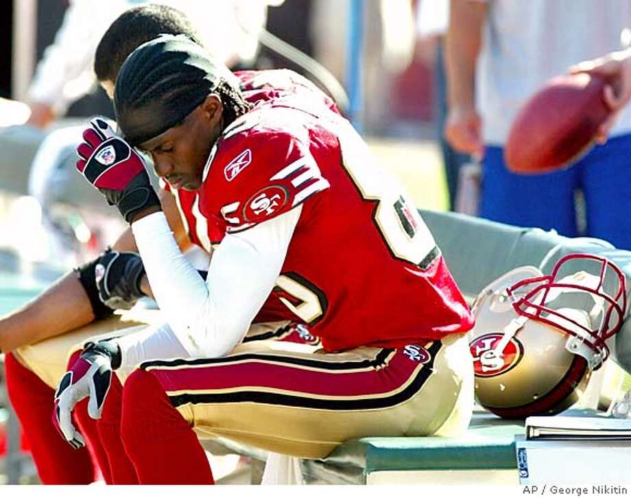 San Francisco 49ers Brandon Lloyd sits on the bench in the fourth quarter during play against the Indianapolis Colts Sunday Oct. 9, 2005 in San Francisco. The Colts beat the 49ers 28-3. (AP Photo/George Nikitin) Photo: GEORGE NIKITIN