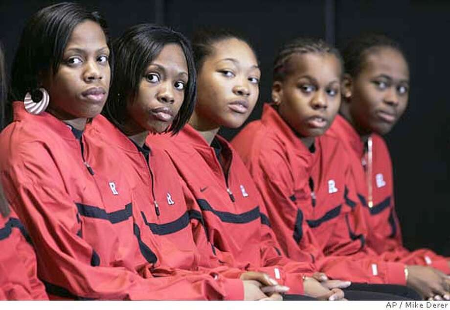 Some members of Rutgers women's basketball team listen as coach C. Vivian Stringer speaks at a news conference on campus in Piscataway, N.J., Tuesday, April 10, 2007, to react to remarks directed at her team made on air by radio personality Don Imus. The team said they would meet privately with Imus. Players are Rashidat Junaid, from left, Myia McCurdy, Brittany Ray, Epiphanny Prince and Dee Dee Jernigan, all freshmen. (AP Photo/Mike Derer) EFE OUT Photo: Mike Derer
