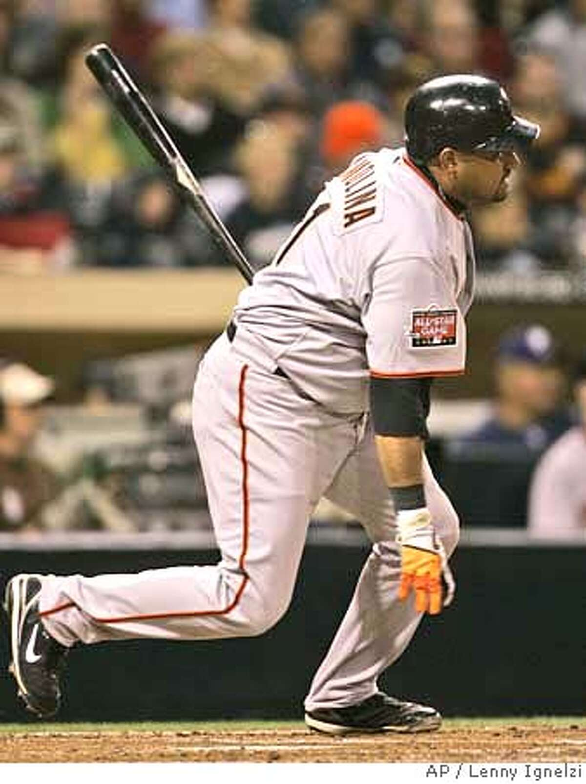 San Francisco Giants' Bengie Molina watches his RBI single go into left field in the second inning against the San Diego Padres during their baseball game in San Diego, Tuesday, April 10, 2007. Molina drove in two runs by the fourth inning. (AP Photo/Lenny Ignelzi)