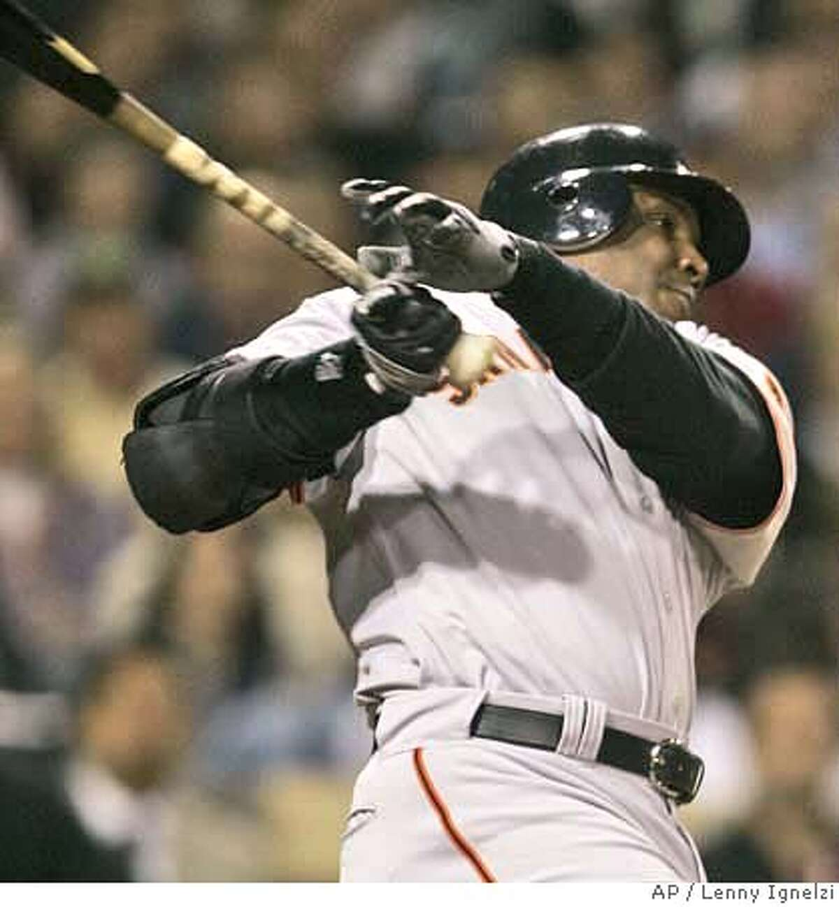 San Francisco Giants' Barry Bonds lashes an RBI single to right during the Giants' three-run fifth inning against the San Diego Padres in a baseball game in San Diego Tuesday, April 10, 2007. (AP Photo/Lenny Ignelzi)