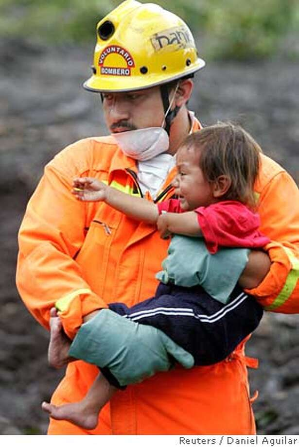 A Guatemalan rescue worker carries a baby out of a mudslide affected zone in the Maya Indian village Panabaj, Guatemala October 8, 2005. Around 1,400 people died under a huge mudslide in the Guatemalan village of Panabaj that was triggered by torrential rains from Hurricane Stan, the fire brigade said on Saturday. REUTERS/Daniel Aguilar Ran on: 10-09-2005  A Guatemalan rescue worker carries a baby out of the village of Panabaj, which was hit by mudslides after Hurricane Stan. Photo: DANIEL AGUILAR