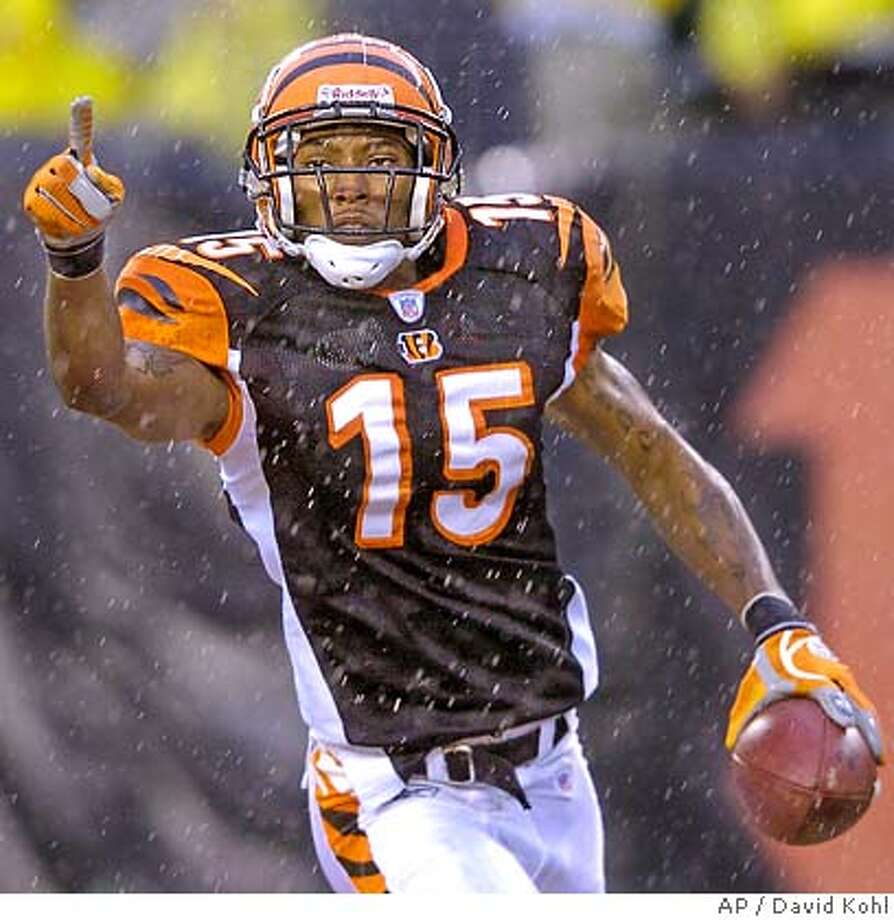 ** FILE ** Cincinnati Bengals receiver Chris Henry celebrates after catching a touchdown pass against the Pittsburgh Steelers in a football game in Cincinnati, in this Dec. 31, 2006 file photo. (AP Photo/David Kohl) Photo: David Kohl