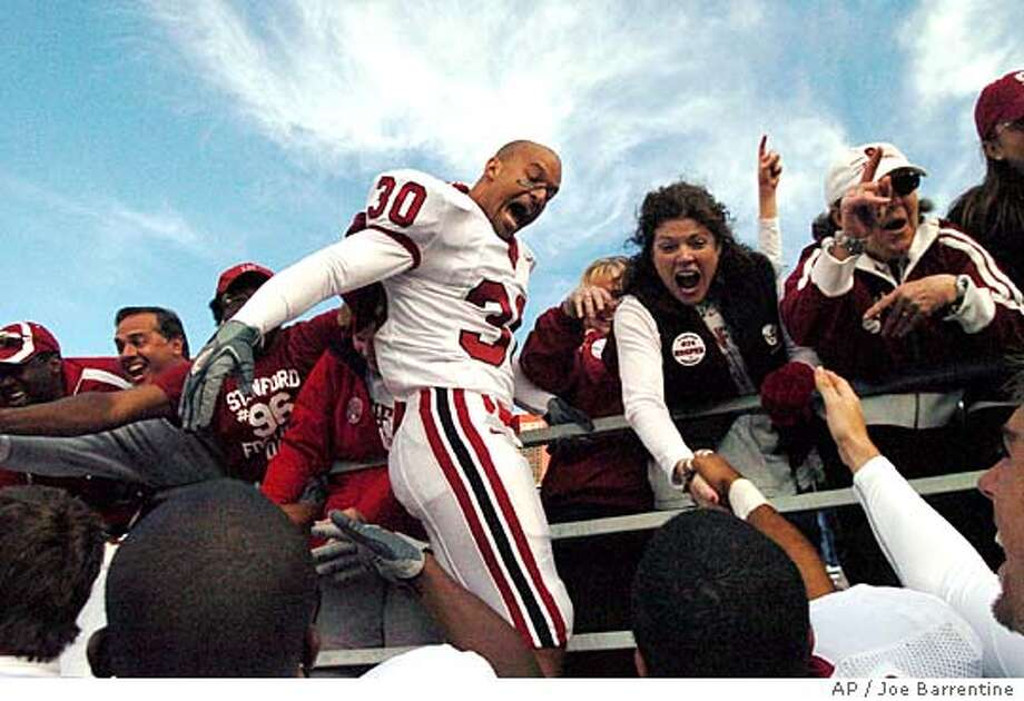 Stanford's Marcus McCutcheon celebrates Stanford's 24-21 victory over Washington State with some fans and his teammates on Saturday, Oct. 8, 2005, in Pullman, Wash. (AP Photo/Joe Barrentine) Ran on: 10-09-2005  Stanford's Marcus McCutcheon joins some Cardinal rooters in celebrating the victory at Washington State University. Ran on: 10-09-2005  Stanford's Marcus McCutcheon joins some Cardinal rooters in celebrating the victory at Washington State University. Ran on: 10-09-2005  Stanford's Marcus McCutcheon joins some Cardinal rooters in celebrating the victory at Washington State. Ran on: 10-09-2005 Ran on: 10-09-2005 Photo: JOE BARRENTINE