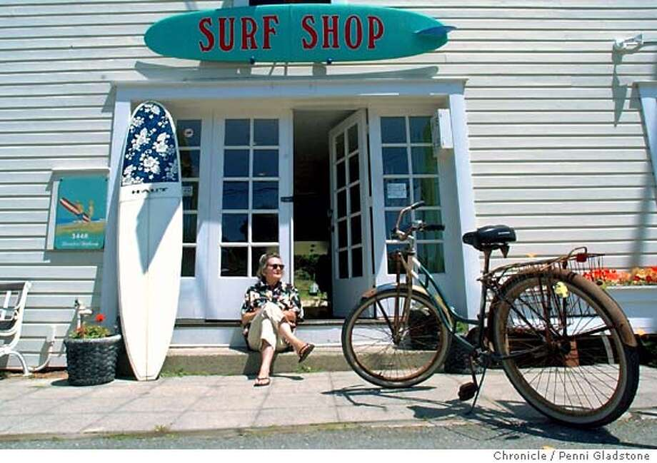 Stinson Beach from a local's point of view. Millicent Meade is the owner of Live Water Surf Shop on the main drag. She is with her rusty Schwinn bicycle in front of her shop. Shot on 6/2/03 in Stinson Beach. 6/2/03 in STINSON BEACH. PENNI GLADSTONE / The Chronicle Photo: PENNI GLADSTONE