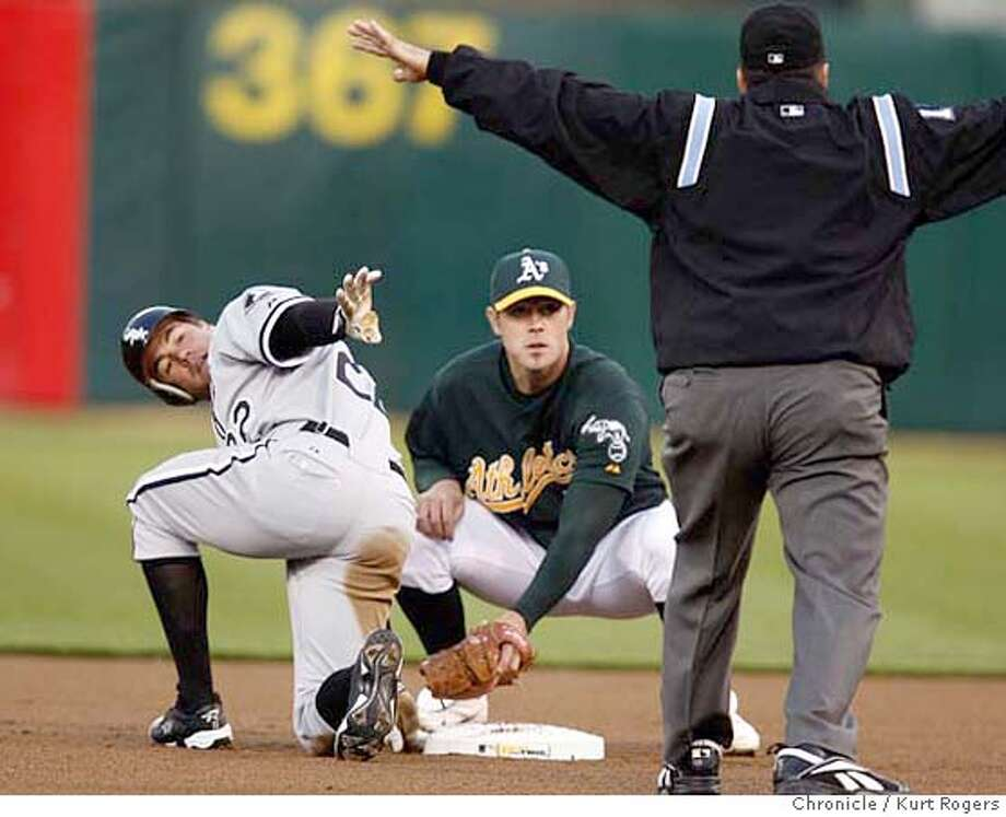 Scott Podsednik and a's Short stop Bobby Crosby look to Joe West for the call in the first inning.  The Oakland Athletics vs the Chicago White Sox Opening night for the Oakland Athletics  MONDAY, APRIL 9, 2007 KURT ROGERS OAKLAND THE CHRONICLE  KURT ROGERS/THE CHRONICLE Photo: KURT ROGERS
