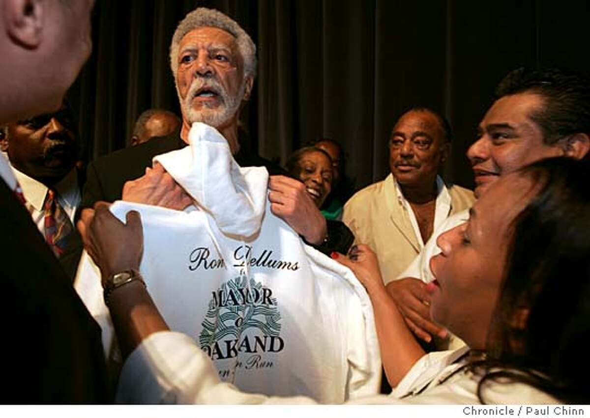 Shorrron Levy (right) presented the new candidate with a campaign shirt after his announcement. Former East Bay congressman Ron Dellums announced his candidacy for mayor of Oakland during an energetic gathering at Laney College on 10/7/05 in Oakland, Calif. PAUL CHINN/The Chronicle