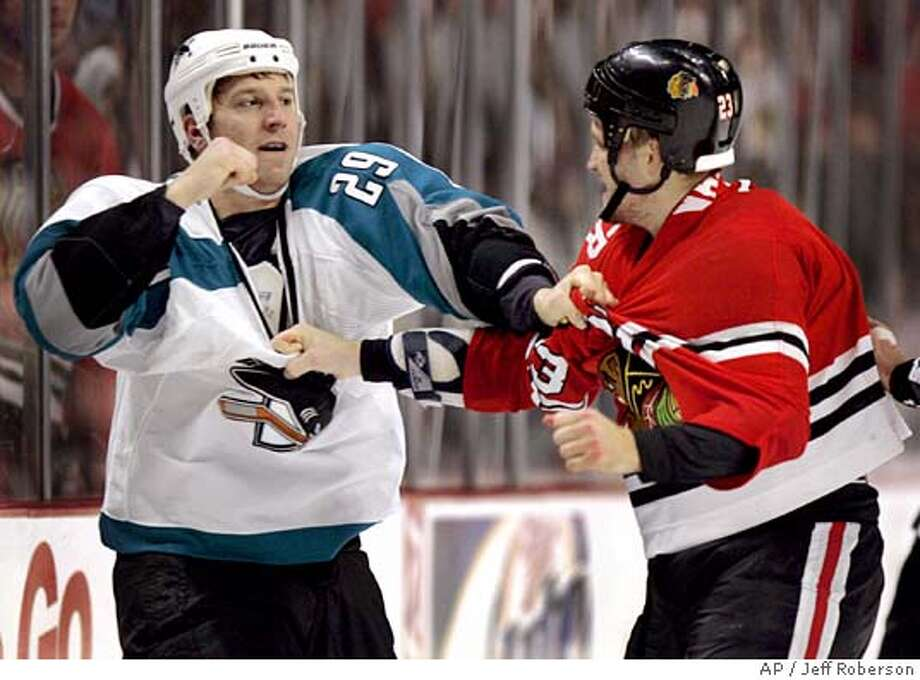 San Jose Sharks' Ryane Clowe, left, and Chicago Blackhawks' Jim Vandermeer, right, fight during the third period Friday, Oct. 7, 2005 in Chicago. The Blackhawks won 6-3. (AP Photo/Jeff Roberson) Ran on: 10-08-2005  Ryan Clowe (left) of the Sharks squares off with Chicago's Jim Vandermeer in the third period of the Blackhawks 6-3 victory. Photo: JEFF ROBERSON