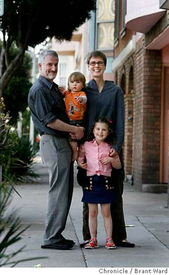 .JPG  Outside their Mission district flat, l-r Jeff Goldberg, Milo (1 year) mother Gillian Gillett and daughter Lucy (5 years) in the city they love.  San Francisco's middle class can't afford to buy a home in the city of San Francisco. Gillian Gillett andJeff Goldberg and their two children Lucy and Milo are stuck renting because there are no affordable homes for them to buy...for now they rent in the Mission District.  {Brant Ward/San Francisco Chronicle}4/2/07 Photo: Brant Ward