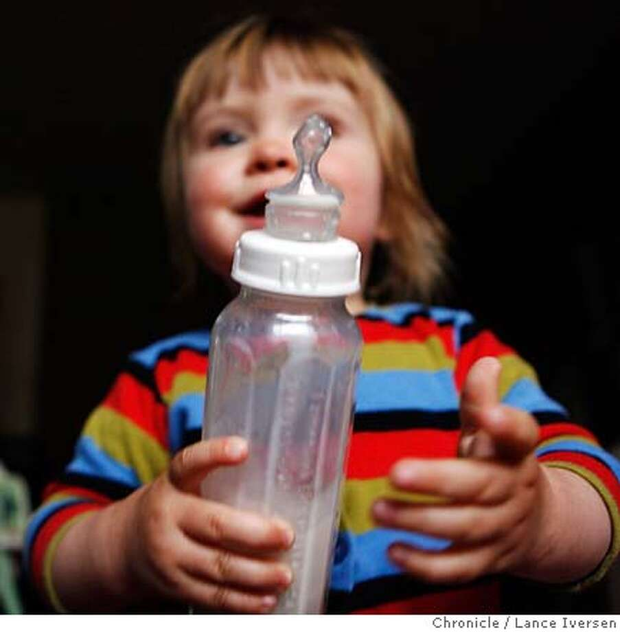 BOTTLES09_19593.JPG  Glass baby bottles, long considered an anachronism, are making such a comeback that parents can't get their hands on them. 16 mo old Lucina, Lippman from Berkeley holds a new glass bottle with organic formula. Online and brick-and-mortar retailers have reported a shortage of glass baby bottles, spurred by media reports that hard plastic bottles leach a dangerous toxin. Parents suddenly concerned about plastics say they'd rather be safe than sorry, but are having a hard time finding glass bottles. Makers of polycarbonate plastic bottles say they're safe.  (APRIL 6) LIPPMAN (cq, Subject) Photo By Lance Iversen / The Chronicle  Photo taken on 4/6/07, in BERKELEY, CA. MANDATORY CREDIT PHOTOG AND SAN FRANCISCO CHRONICLE/NO SALES MAGS OUT Photo: By Lance Iversen