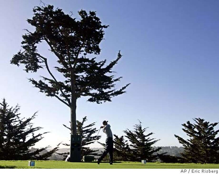 Tiger Woods tees off on the 14th hole during the World Golf Championships-American Express Championship at Harding Park in San Francisco, Thursday, Oct. 6, 2005. (AP Photo/Eric Risberg) **EFE OUT** Photo: ERIC RISBERG