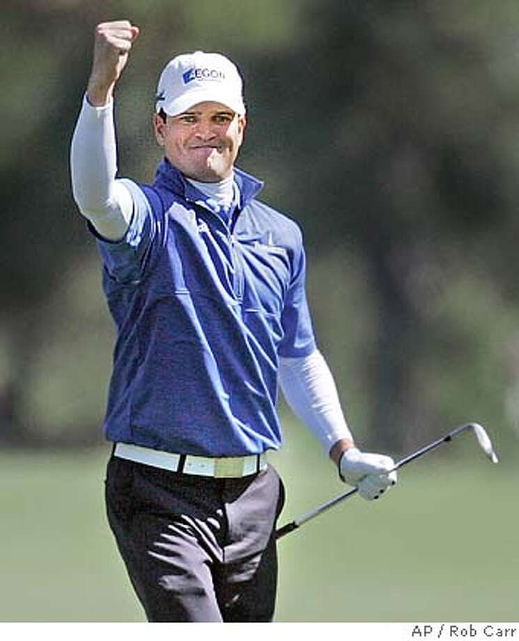 Zach Johnson reacts after chipping in for birdie on the eighth hole during the final round of the 2007 Masters golf tournament at the Augusta National Golf Club in Augusta, Ga., Sunday, April 8, 2007. (AP Photo/Rob Carr) Photo: Rob Carr