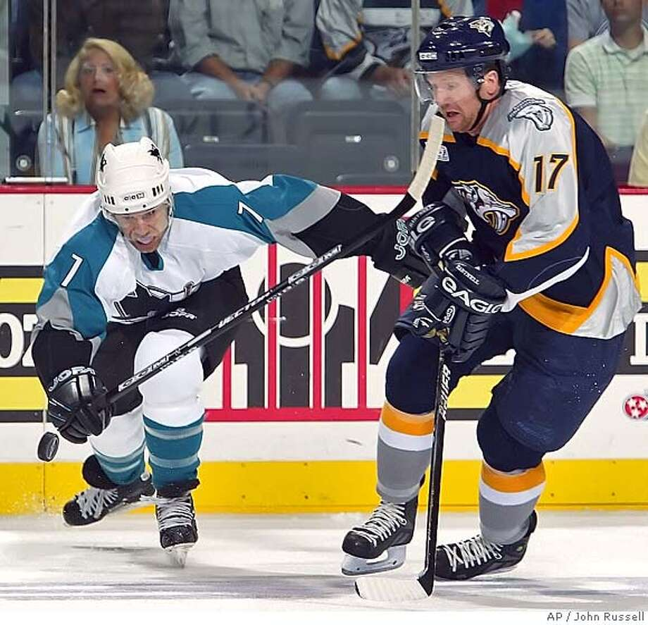 Nashville Predators left wing Scott Hartnell (17) battles San Jose Sharks defenseman Brad Stuart (7) for a loose puck during the first period in Nashville, Tenn., Wednesday, Oct. 5, 2005. (AP Photo/John Russell) Photo: JOHN RUSSELL