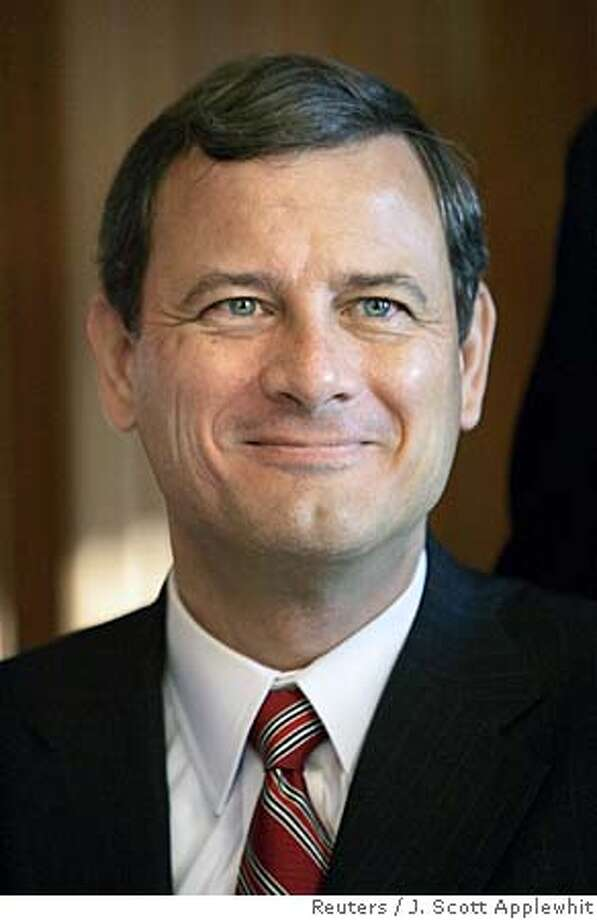 U.S. Chief Justice John Roberts smiles before his investiture ceremony at the Supreme Court in Washington, October 3, 2005. Roberts was installed on Monday as the nation's 17th chief justice in a special Supreme Court ceremony attended by President George W. Bush, family members and his high court colleagues. REUTERS/J. Scott Applewhite/Pool 0 Photo: POOL
