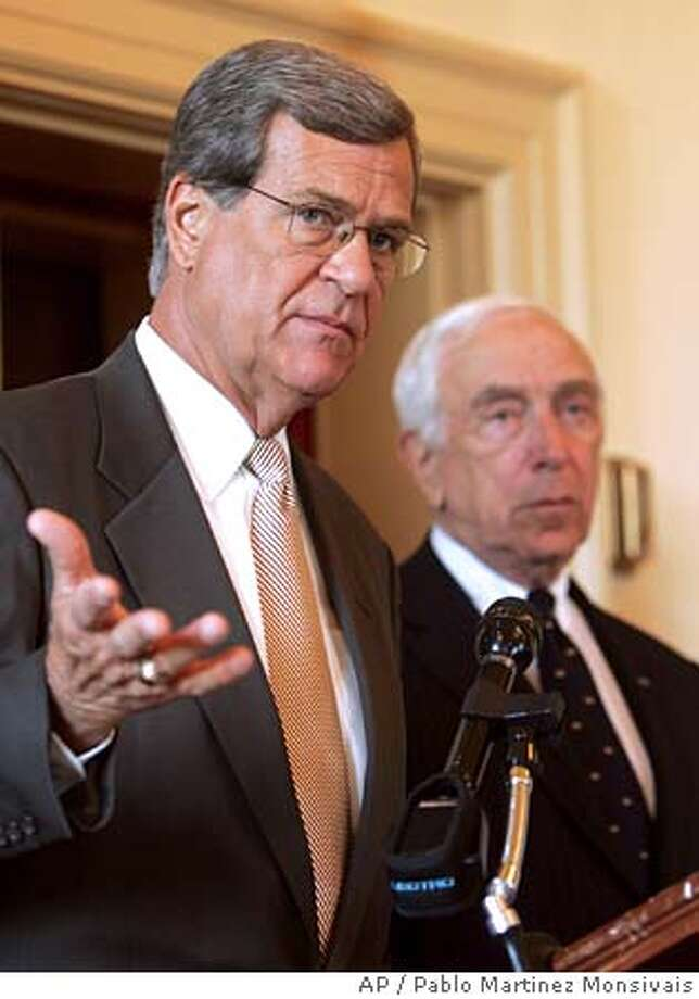 Sen. Trent Lott, R-Miss., left, Sen. Frank Lautenberg, D-N.J., right, during a press conference to announce Amtrak reform legislation, on Capitol Hill, Wednesday, July 27, 2005 in Washington. (AP Photo/Pablo Martinez Monsivais) Ran on: 08-18-2005  Trent Lott Photo: PABLO MARTINEZ MONSIVAIS