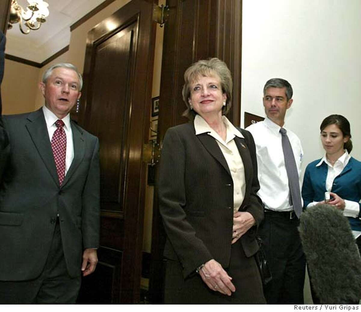 U.S. Supreme Court nominee Harriet Miers (C) and Senator Jeff Sessions (R-AL) (L) walk out to meet journalists after their meeting at the Hart Senate office building on Capitol Hill in Washington October 4, 2005. President George W. Bush on Tuesday defended his choice of White House counsel Miers for the Supreme Court and rejected charges of cronyism from some Republicans who questioned whether she will be sufficiently conservative to shift the court to the right. REUTERS/Yuri Gripas 0