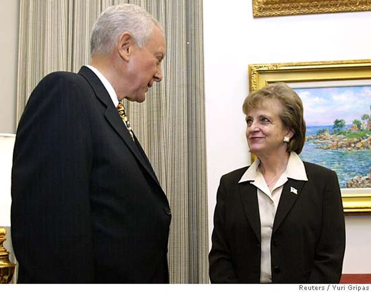 U.S. Supreme Court nominee Harriet Miers (R) talks to Senator Orrin Hatch (R-UT) at the Hart Senate office building on Capitol Hill in Washington October 4, 2005. President George W. Bush on Tuesday defended his choice of White House counsel Miers for the Supreme Court and rejected charges of cronyism from some Republicans who questioned whether she will be sufficiently conservative to shift the court to the right. REUTERS/Yuri Gripas